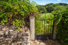 Old Rusted Garden Gate With Iron Cross