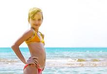 Summer Fun Beach Woman Splashing Water. Panorama Landscape Of Tropical Ocean On Travel Holiday. Bikini Girl Running In Freedom And Joy With Hands Up Enjoying The Sun.