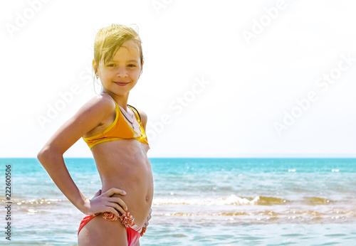 Obraz Summer fun beach woman splashing water. Panorama landscape of tropical ocean on travel holiday. Bikini girl running in freedom and joy with hands up enjoying the sun. - fototapety do salonu