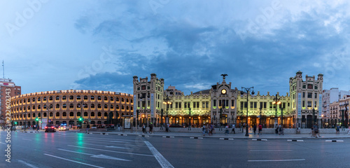 Foto op Plexiglas Noord Europa North Station most important train station in Valencia rail transport, Estacion del Norte Spain wide angle, city lights lighting, night view panorama with the bullring