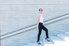 Business Woman Climbs The Stairs