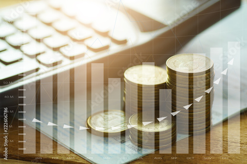 Obraz money coins stacked with calculator on book bank and capital finance with graph concept - fototapety do salonu