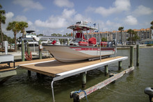 Dunedin, Florida, USA. A Dunedin Fire Rescue, Boat Out Of The Water Standing On Electric Lowering Dock.