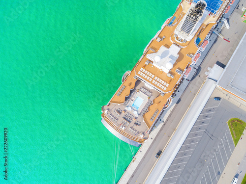 Garden Poster Shipwreck Aerial View by Drone of Cruise ship at harbour. Top view of beautiful large white liner in yacht club. Luxury cruise in sea water. Marina dock. Ship is moored at the quay. Turquoise water