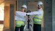 Constructor, builders team discuss a building plan, close up.