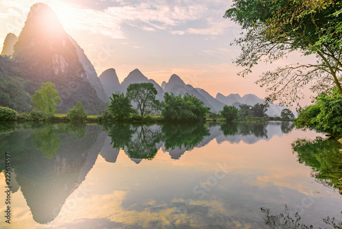 Photo Stands Guilin Sunset view of Li River. Yangshuo. Guangxi Province.
