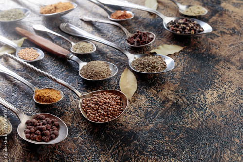 Foto op Aluminium Aromatische Different spices in spoons on a vintage background.