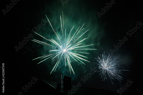 Fototapety, obrazy: A teal firework over a black roof