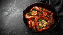 Tiger Prawns Fried In Butter With, Lemon Juice, Garlic And White Wine Served In Cast Iron Skillet With Parsley