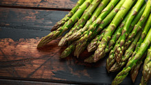 Fresh Raw Green Asparagus On Rustic Wooden Background