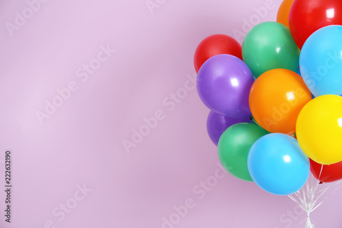 Fotografia Bunch of bright balloons and space for text against color background