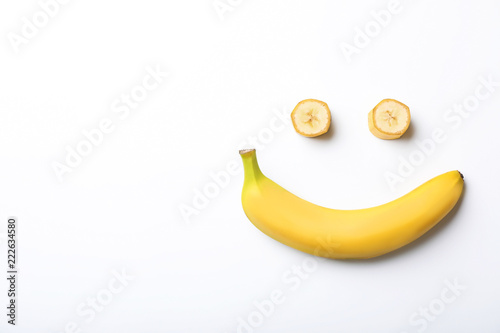 Funny flat lay composition with bananas on white background