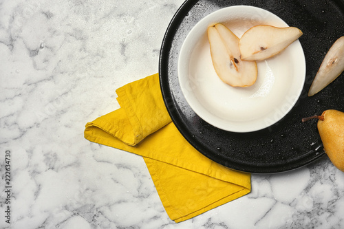 Flat lay composition with ripe pears on marble background. Space for text