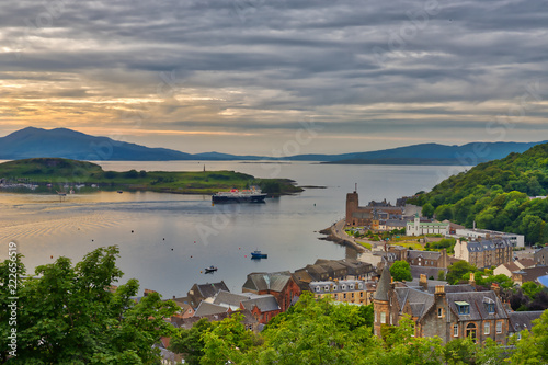 A moody view from a hill in the port town of Oban, Scotland looking out on the t Wallpaper Mural