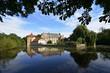 canvas print picture - Wasserschloss Tatenhausen mit blauem Himmel und Wolken, NRW, Deutschland, Water castle Tatenhausen with blue sky and clouds, Germany