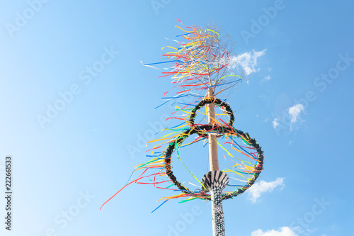 Poster Europa typical greman may pole or maibaum at the festival in front of blue sky, spring holiday concept