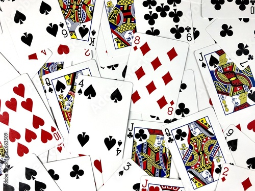 фотография  deck of scattered playing cards filling the frame