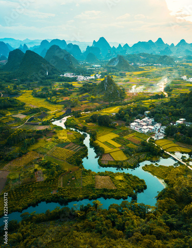 Staande foto Asia land Aerial photo of a sunset over rice fields