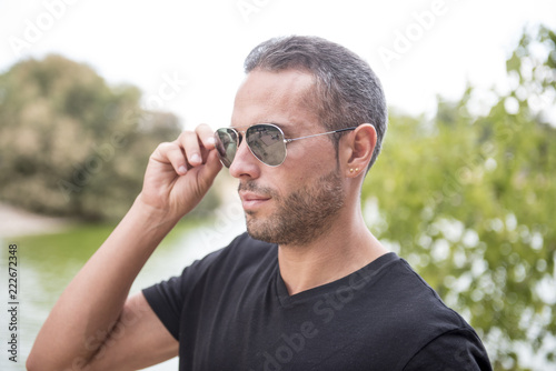 Attractive man posing in the park