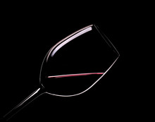 Elegant Glass Of Red Wine On A Black Background