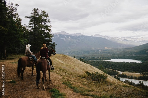 horseback riding in the mountains Wallpaper Mural