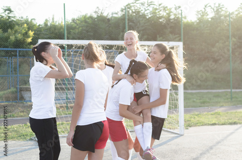 Female handball team celebrating