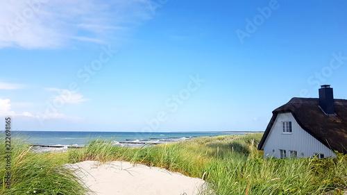 Acrylic Prints Roe House with Roof ree or thatch on the beach