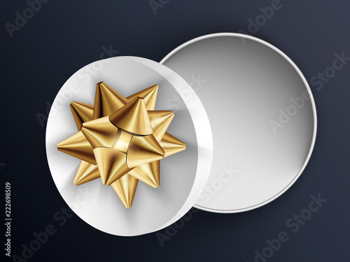 Photo  Open white gift round box with gold bow