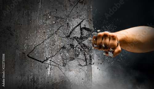 Obraz na plátně  Hand breaking through the wall. Mixed media