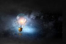 Glass Bulb In Dark Sky. Mixed Media