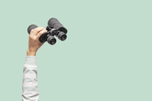 Woman With Binoculars On Green Background, Looking Through Binoculars, Journey, Find And Search Concept.