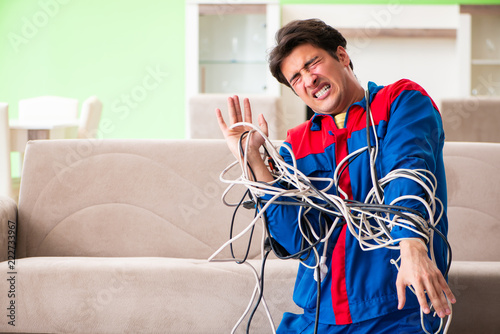 Fotografie, Obraz Electrician contractor with tangled cables