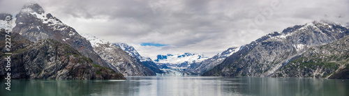 Johns Hopkins Glacier and mountains on a cloudy day in Glacier Bay National park Alaska