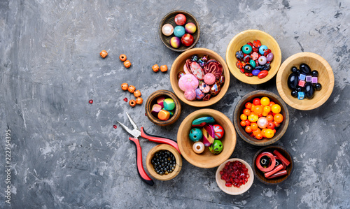 Poster Confiserie Colorful beads in wooden bowls