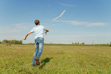 Hansome Teenager  Throwing DIY Glider In The Grass. Dream Conception Photo.