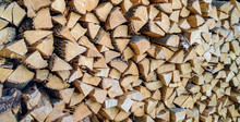 A Pile Of Stacked Firewood, Prepared For Heating The House.