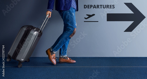 Traveling Concept, Young Traveler Walking with Suitcase and Follow the Departure Fototapeta