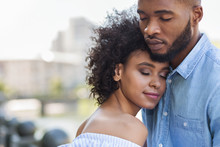 Tender Black Couple Hugging With Closed Eyes