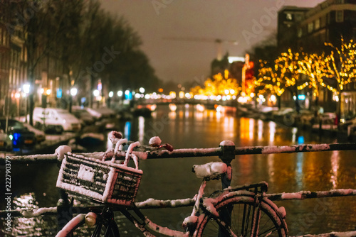 Photo  Bicycles Parked Along a Bridge Over the Canals of Amsterdam