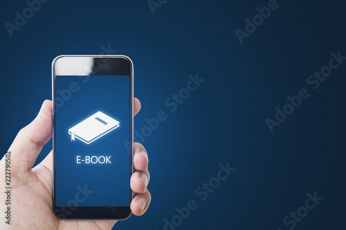 E-book on on mobile smart phone, hand using e-book on mobile device. Online education, e-learning and e-book concept