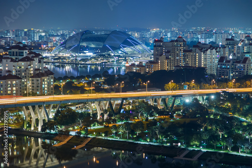 Singapore skyline. National Stadium. Aerial view to illuminated city at night