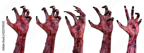 Foto Terrible zombie hands with bloody wounded
