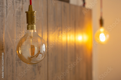 Authentic vintage interior design with old lamp on the wooden wall