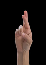 Cross Fingers Of Woman's Hand With Rim Light  (isolated On Black Background With Clipping Path) For Lie And  Wishing For Good Luck Gesture