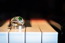 Emerald Wedding Ring On Piano Keys