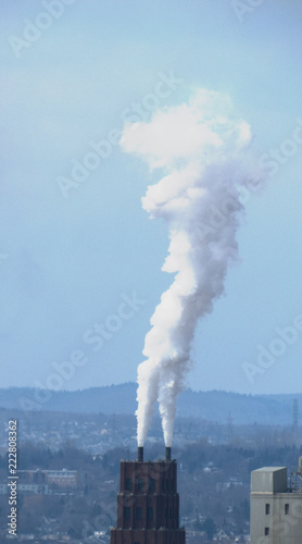 Fotobehang Rook Vertical photo - Tall Smoke/Vapor cloud going out of an industrial building from Quebec City, Canada.