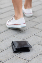 Lost Leather Wallet On The Ground
