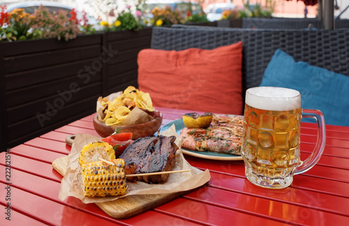 Beer and savory food on table