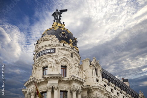 Valokuva  Metropolis - one of the most beautiful buildings in Madrid, Spain with dramatic