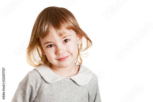Portrait of smiling little baby girl isolated on a white background.